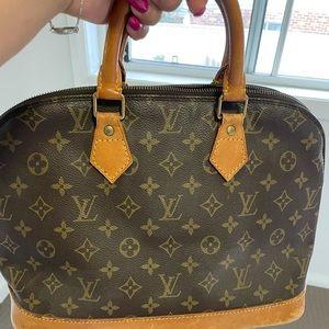 Louise Vuitton Alma handbag authentic